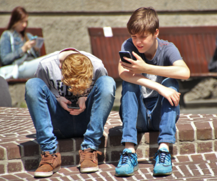 Two boys on cellphones